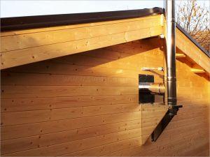 Srubová chata s vytápěním, nerezový komín